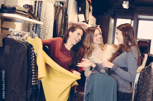Three Women in a Clothing Store - 73111189