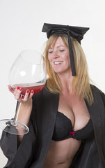 Graduation celbration graduate drinking from a large glass