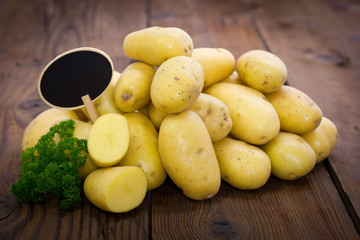 Fresh, organic potatoes with empty price tag