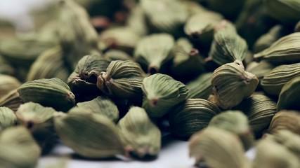 Pile of green cardamom seeds,rotating