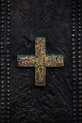 Cross on the bronze background
