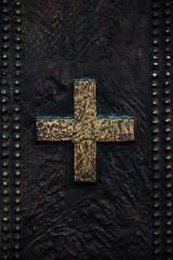 Cross on the bronze background