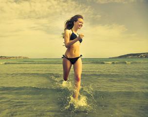 Girl running in the water