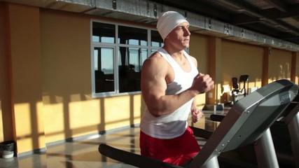 Sportsman on running track