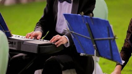 Musician Playing Keyboard At Band