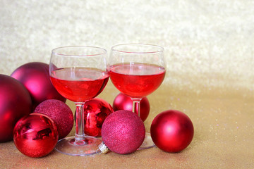 Two Wine Glasses Toast by Christmas Bulb Decorations
