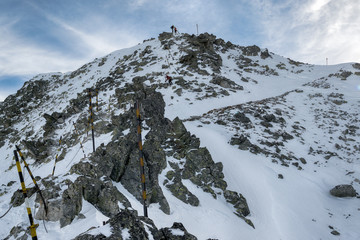 climbers walking down  in line in the Mountain of Rila at the pe