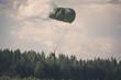 Leinwandbild Motiv Parachutist in the war