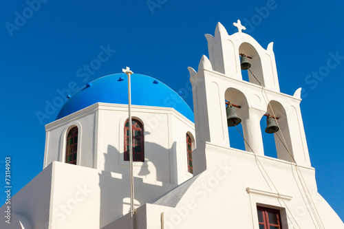 canvas print picture White church with a blue roof seen in Oia