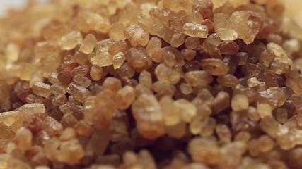 Brown sugar from sugar cane,rotating