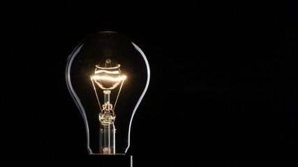 Light bulb over dark background. UHD, 4K