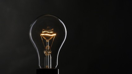 Light bulb over dark background. UHD, 4K