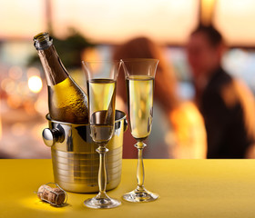 Champagne flutes and chilled bottle.