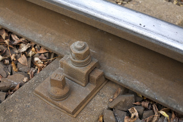 Railroad track bolt as  background.