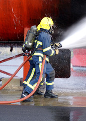 fire fighter in BA with hose