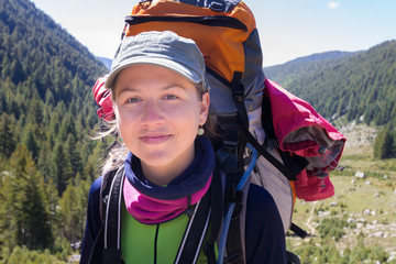 Happy young woman backpacker portrait