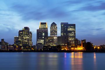 London Docklands skyline over Thames river at night
