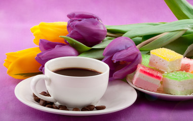 Nice breakfast with cup of coffee, flowers, blank paper for text