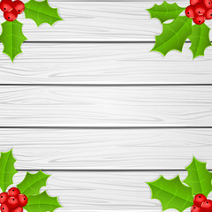 Holly berry on white wooden background