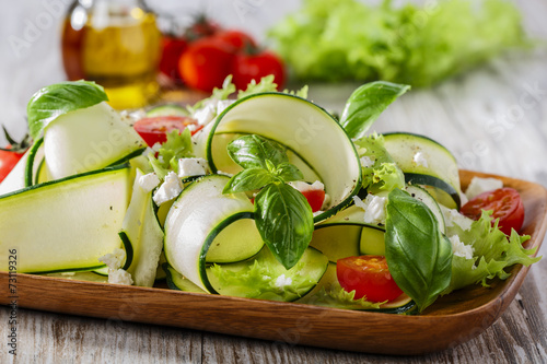 Zucchini salad with tomatoes and cheese - 73119326