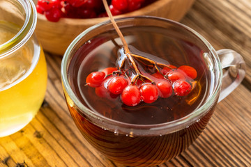 Hot herbal tea with honey and viburnum