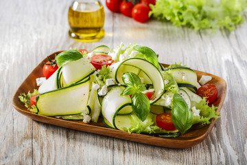 Zucchini salad with tomatoes and cheese