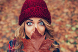 beautiful blonde with leaf in front of face