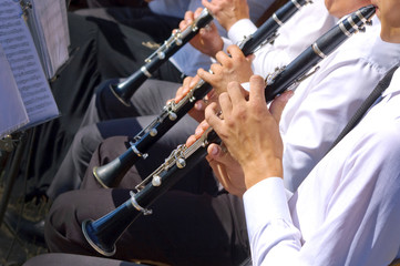 Musician playing clarinet in street orchestra