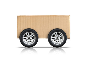 Cardboard box with automotive wheels isolated on white