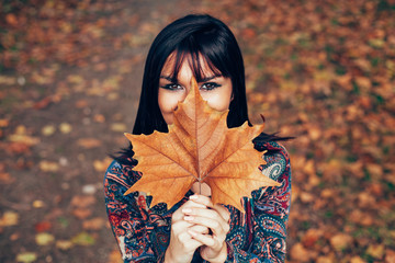 Beautiful women with leaf in front of face