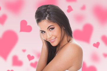 Woman Smiling Amidst Hearts Over Colored Background