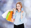 Happy Businesswoman With Shopping Bags And Credit Card
