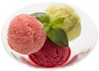 several fruit balls of sweet sorbet in a glass