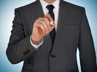 Businessman with pen writing