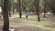 People running in the park, slow motion shot, steadycam shot
