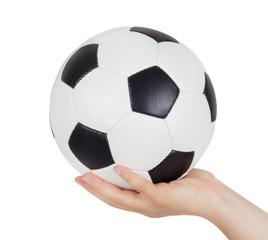Hand holding soccer ball