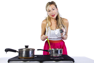young cuacasian female making soup on a stove