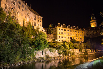 View at a castle in Cesky Krumlov during the nighttime.