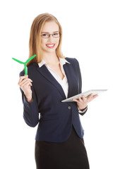 Businesswoman holding a model of propeller