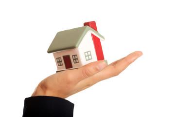 Businesswoman holding house model