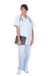 Female Nurse Holding Digital Tablet Against White Background