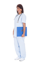 Happy Female Nurse Standing Against White Background