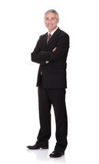 Portrait Of Confident Businessman With Arms Crossed