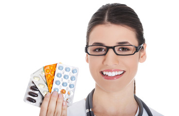 Female doctor holding pills