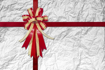 Red Ribbon on Crumpled white Paper for background