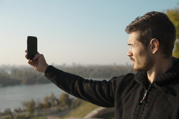Attractive Man Taking Photo Outdoor