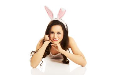 Portrait of lying woman wearing bunny ears