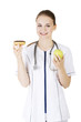 Nutritionist holding a donut and apple