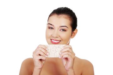Woman holding crisp bread