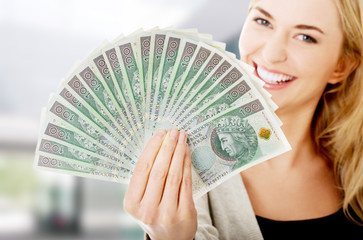 Woman holding a clip of polish money